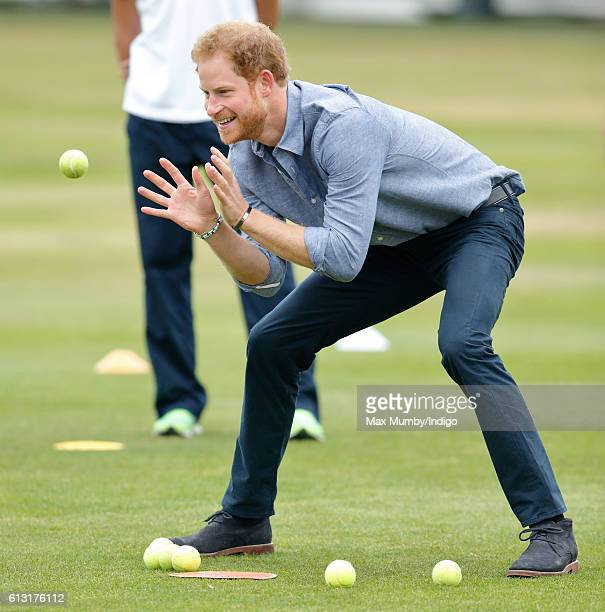 Prince Harry takes part in a training session as he attends an event to mark the expansion of the Coach Core sports coaching apprenticeship programme...