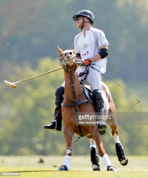 Prince Harry takes part in the Audi Polo Challenge at Coworth Park Polo Club on May 7 2017 in Ascot England