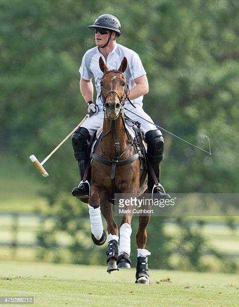 Prince Harry takes part on day one of the Audi Polo Challenge at Coworth Park on May 30 2015 in London England