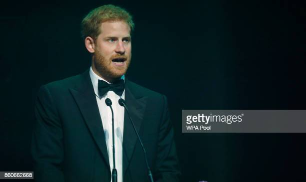 Prince Harry talks after receiving a posthumous Attitude Legacy Award on behalf of his mother Diana Princess of Wales at the Attitude Awards on...