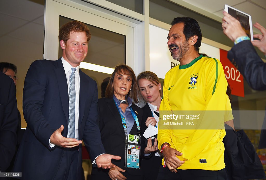 <a gi-track='captionPersonalityLinkClicked' href=/galleries/search?phrase=Prince+Harry&family=editorial&specificpeople=178173 ng-click='$event.stopPropagation()'>Prince Harry</a> talks to a guest in the VVIP lounge prior to the 2014 FIFA World Cup Brazil Group A match between Cameroon and Brazil at Estadio Nacional on June 23, 2014 in Brasilia, Brazil.