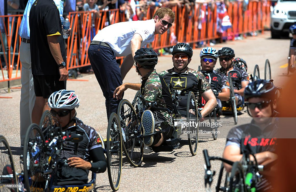 Prince Harry talks to competitors in the 10K Recumbent race before the start of the race. The fourth annual Warrior Games cycling event took started and finished at Falcon Stadium on the grounds of the Air Force Academy in Colorado Springs, CO on May 12, 2013. HRH Prince Harry was on hand to start the race as well as to hand out medals at the finish line. A total of 260 wounded, ill and injured service members and veterans came to compete in the week long games. Members of the Army, Marine Corps, Navy/Coast Guard/Air Force. Special Operations and the British Armed Forces all took part in the competition. Other events included in the Warrior Games are shooting, sitting volleyball, track & field and wheelchair basketball.
