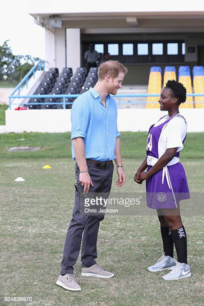 Prince Harry talks to Harmony Edwards aged 14 attends a youth sports festival at Sir Vivian Richards Stadium showcasing Antigua and Barbuda's...