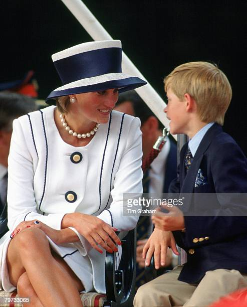 Prince Harry talks to his mother Diana Princess of Wales who wears a suit designed by Tomasz Starzewski to VJ Day commemorations