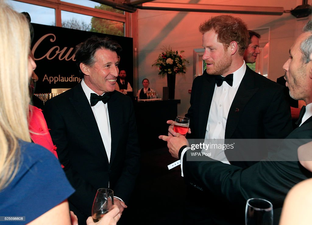 Prince Harry (C) talks to Lord Sebastian Coe (L) during the BT Sport Industry Awards 2016 at Battersea Evolution on April 28, 2016 in London, England. The BT Sport Industry Awards is the most prestigious commercial sports awards ceremony in Europe, where over 1750 of the industry's key decision-makers mix with high profile sporting celebrities for the most important networking occasion in the sport business calendar.