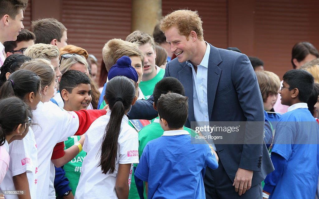 Prince Harry talks to school children at the Launch of the Rugby World Cup Trophy Tour at Twickenham Stadium on June 10, 2015 in London, England.