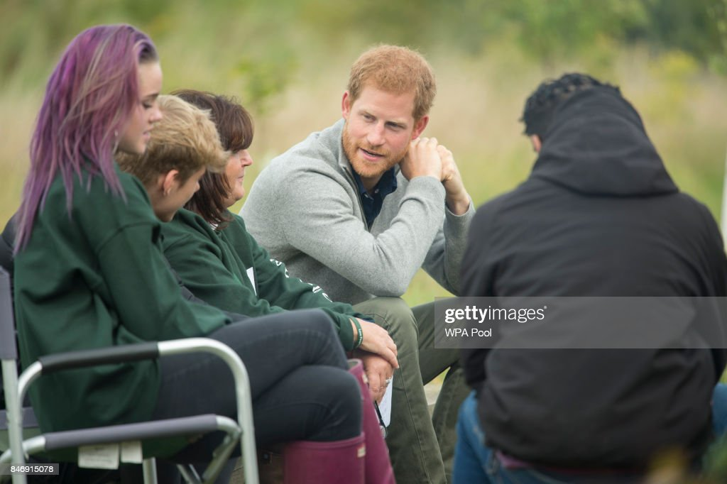 Prince Harry talks to teenagers taking part in the TurnAround Project, run by the Wilderness Foundation to provide support and activities for vulnerable teenagers across Essex on September 14, 2017 near Chelmsford, England.