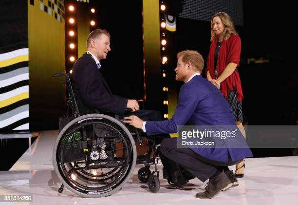 Prince Harry talks to Trevor Greene injured while in Afghanistan and his wife Debbie Greene as he visits the Air Canada Centre ahead of tomorrow's...