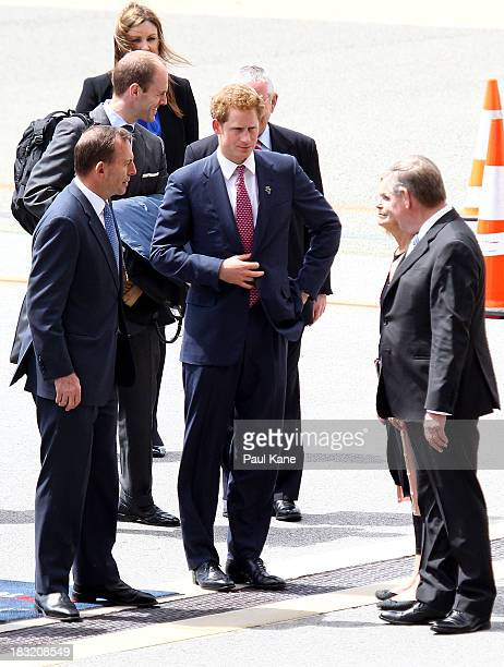 Prince Harry talks with Australian Prime Minister Tony Abbott and West Australian Premier Colin Barnett after arriving at Perth Airport on October 6...