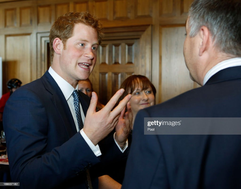 <a gi-track='captionPersonalityLinkClicked' href=/galleries/search?phrase=Prince+Harry&family=editorial&specificpeople=178173 ng-click='$event.stopPropagation()'>Prince Harry</a> (L) talks with guest at a reception at the Sanctuary Golf Course on May 10, 2013 in Sedalia, Colorado. HRH will be undertaking engagements on behalf of charities with which the Prince is closely associated on behalf also of HM Government, with a central theme of supporting injured service personnel from the UK and US forces.