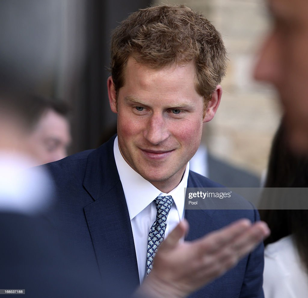 <a gi-track='captionPersonalityLinkClicked' href=/galleries/search?phrase=Prince+Harry&family=editorial&specificpeople=178173 ng-click='$event.stopPropagation()'>Prince Harry</a> talks with guest at a reception at the Sanctuary Golf Course on May 10, 2013 in Sedalia, Colorado. HRH will be undertaking engagements on behalf of charities with which the Prince is closely associated on behalf also of HM Government, with a central theme of supporting injured service personnel from the UK and US forces.