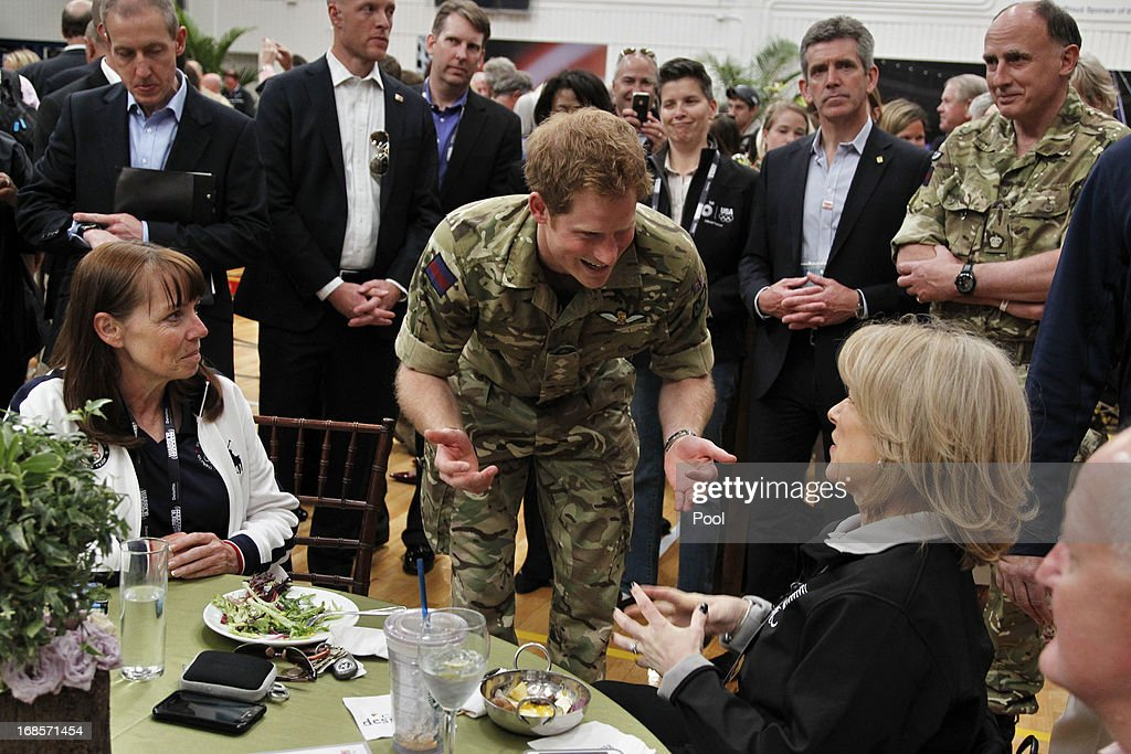 Prince Harry talks with invited guests at the Noble Cause Luncheon, before the opening of the 2013 Warrior Games at the U.S. Olympic Training Center on May 11, 2013 in Colorado Springs, Colorado. The Warrior Games is a competition for wounded, ill and injured service members. HRH will be undertaking engagements on behalf of charities with which the Prince is closely associated on behalf also of HM Government, with a central theme of supporting injured service personnel from the UK and US forces.