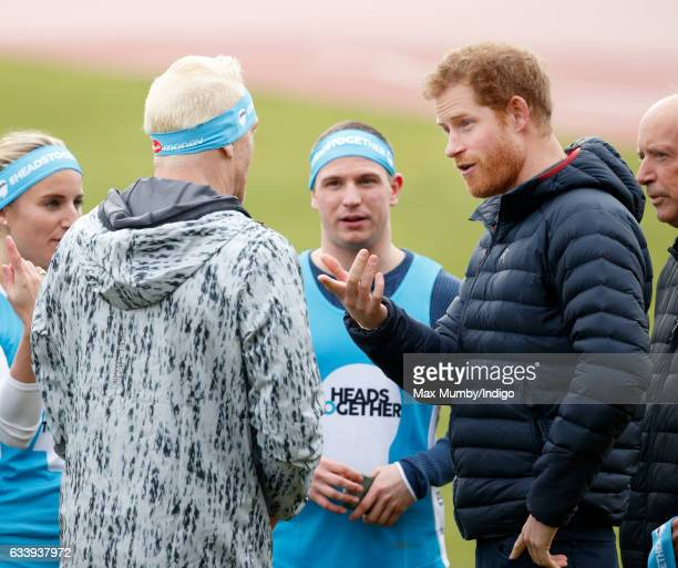 Prince Harry talks with Iwan Thomas as he joins a Team Heads Together London Marathon Training Day at the Queen Elizabeth Olympic Park on February 5...