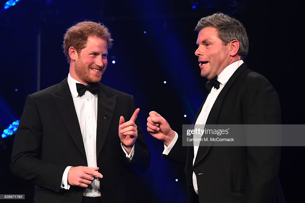 Prince Harry talks with Mark Durden-Smith (R) about the Invictus Games at Battersea Evolution on April 28, 2016 in London, England. The BT Sport Industry Awards is the most prestigious commercial sports awards ceremony in Europe, where over 1750 of the industry's key decision-makers mix with high profile sporting celebrities for the most important networking occasion in the sport business calendar.