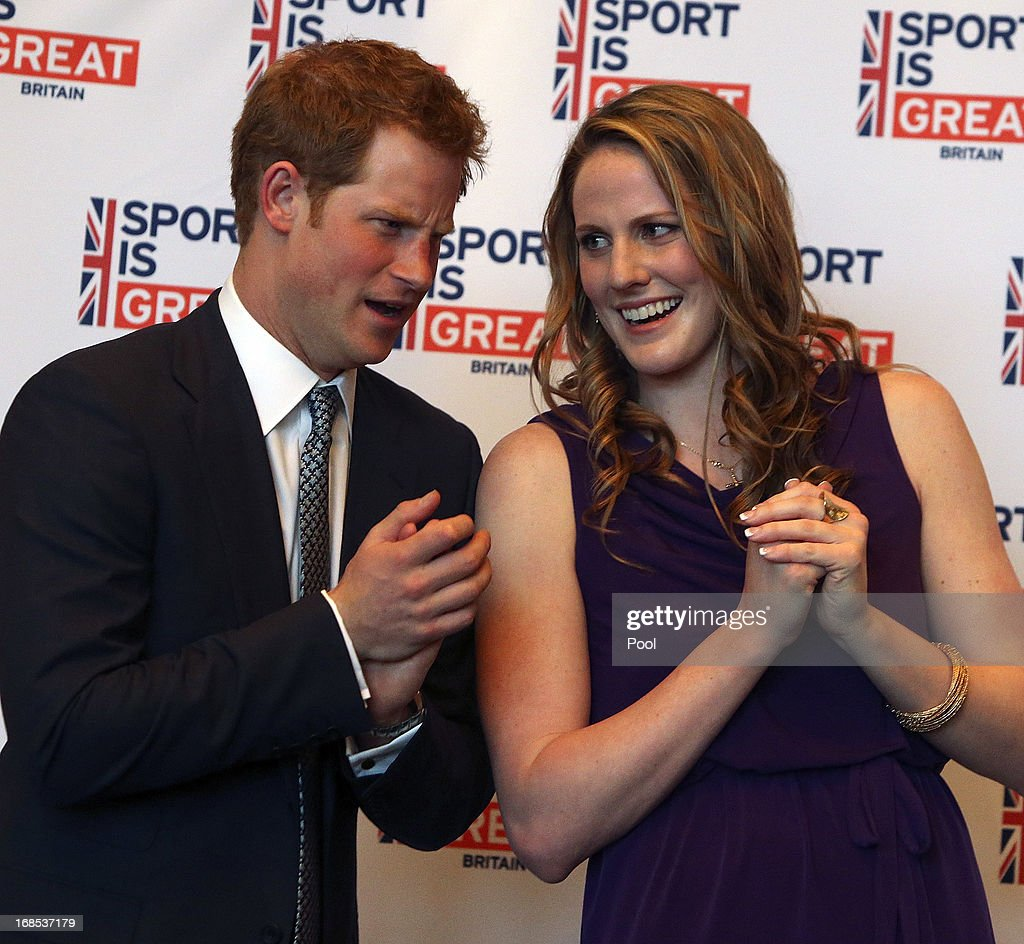 HRH Prince Harry (L) talks with Olympic gold medalist Missy Franklin at a reception at the Sanctuary Golf Course on May 10, 2013 in Sedalia, Colorado. HRH will be undertaking engagements on behalf of charities with which the Prince is closely associated on behalf also of HM Government, with a central theme of supporting injured service personnel from the UK and US forces.