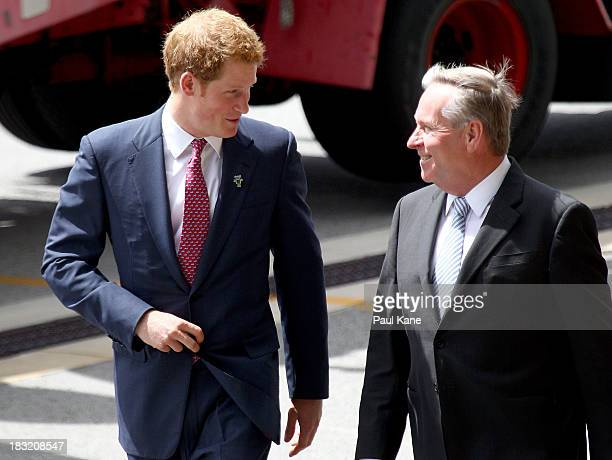 Prince Harry talks with West Australian Premier Colin Barnett after arriving at Perth Airport on October 6 2013 in Perth Australia Prince Harry is on...