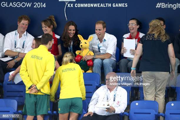 Prince Harry The Duke and Duchess of Cambridge are handed an Australian team mascot as they attend the swimming session at Tollcross Swimming Centre...