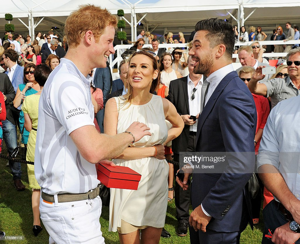 <a gi-track='captionPersonalityLinkClicked' href=/galleries/search?phrase=Prince+Harry&family=editorial&specificpeople=178173 ng-click='$event.stopPropagation()'>Prince Harry</a>, Tonya Meli and <a gi-track='captionPersonalityLinkClicked' href=/galleries/search?phrase=Dominic+Cooper&family=editorial&specificpeople=863047 ng-click='$event.stopPropagation()'>Dominic Cooper</a> attend day 2 of the Audi Polo Challenge at Coworth Park Polo Club on August 4, 2013 in Ascot, England.