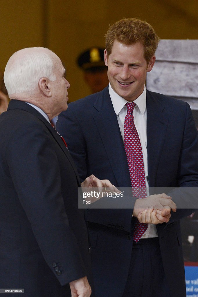 Prince Harry (R) tours a HALO Trust photo exhibit on landmines and unexploded ordinances, with Republican Senator from Arizona John McCain (L),on Capitol Hill on May 9, 2013 in Washington, DC. HRH will be undertaking engagements on behalf of charities with which the Prince is closely associated on behalf also of HM Government, with a central theme of supporting injured service personnel from the UK and US forces.