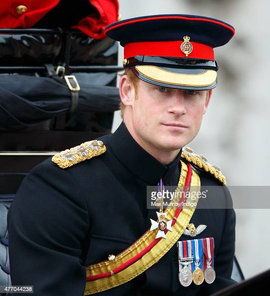 Prince Harry travels down The Mall in a horse drawn carriage during Trooping the Colour on June 13 2015 in London England The ceremony is Queen...