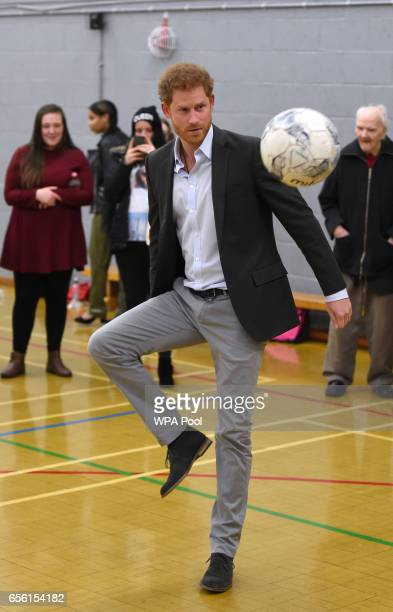 Prince Harry tries his hand at foot volleyball during a visit to a sports session organised by the Pink Lizard youth organisation on the Saffron Lane...