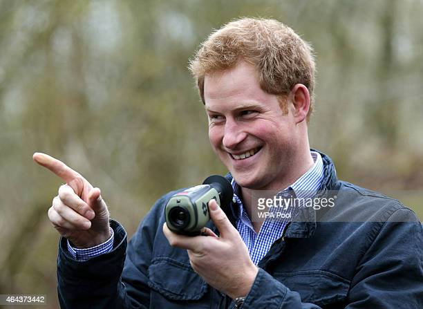 Prince Harry uses a thermal imaging camera as he meets with Red Squirrel Northern England staff who are working with the local community to safeguard...