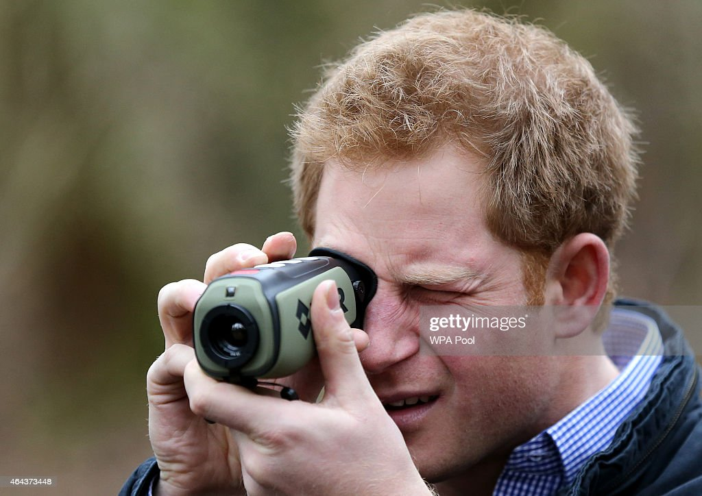 Prince Harry uses a thermal imaging camera as he meets with Red Squirrel Northern England (RSNE) staff who are working with the local community to safeguard the red squirrel (Sciurus vulgaris) population, with the main focus on a grey squirrel (Sciurus carolinensis) control programme at Frankham Woods on February 25, 2015 near Fourstones, United Kingdom.