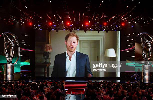 Prince Harry via video link announces the All Blacks player Dan Carter as winner of the Laureus World Comeback of the Year trophy during the 2016...