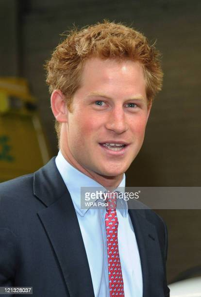 Prince Harry visits Salford Ambulance Headquarters to meet ambulance crew members who were on duty during last week's riots on August 18 2011 in...