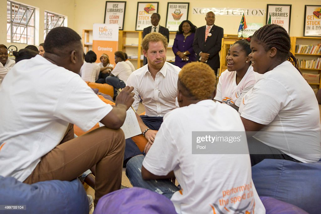 Prince Harry visits Siyabonga Secondary School and meets children participating in the Nelson Mandela Champion within program in Soweto on December 3, 2015 in Johannesburg, South Africa. Prince Harry is visiting South Africa as part of a Royal Tour that has included the Opening of a new Charity Centre for children in Lesotho (Sentebale's Mamohato Children's Centre) and includes stops in Durban, Cape Town, Kruger National Park and Johannesburg.