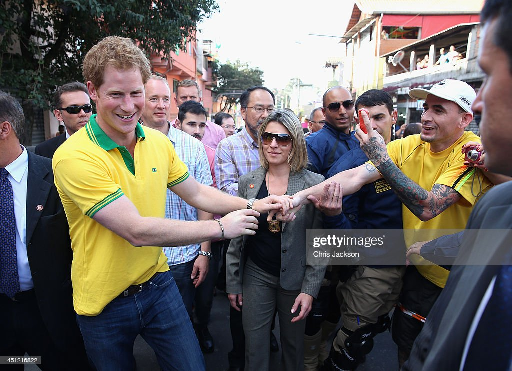 <a gi-track='captionPersonalityLinkClicked' href=/galleries/search?phrase=Prince+Harry&family=editorial&specificpeople=178173 ng-click='$event.stopPropagation()'>Prince Harry</a> walks down the street after visiting the ACER Charity for disadvantaged children on June 25, 2014 in Sao Paulo, Brazil. <a gi-track='captionPersonalityLinkClicked' href=/galleries/search?phrase=Prince+Harry&family=editorial&specificpeople=178173 ng-click='$event.stopPropagation()'>Prince Harry</a> is on a four day tour of Brazil that will be followed by Two days in Chile.