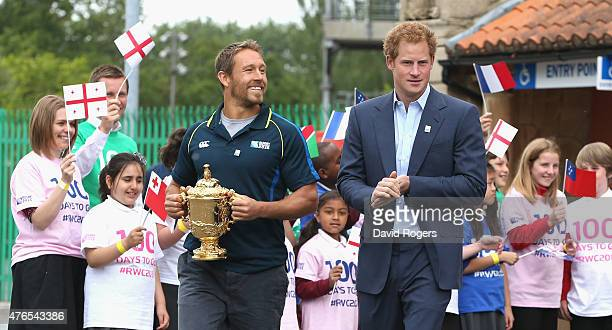 Prince Harry walks with England World Cup winner Jonny Wilkinson as he carries the Webb Ellis Trophy at the Launch of the Rugby World Cup Trophy Tour...
