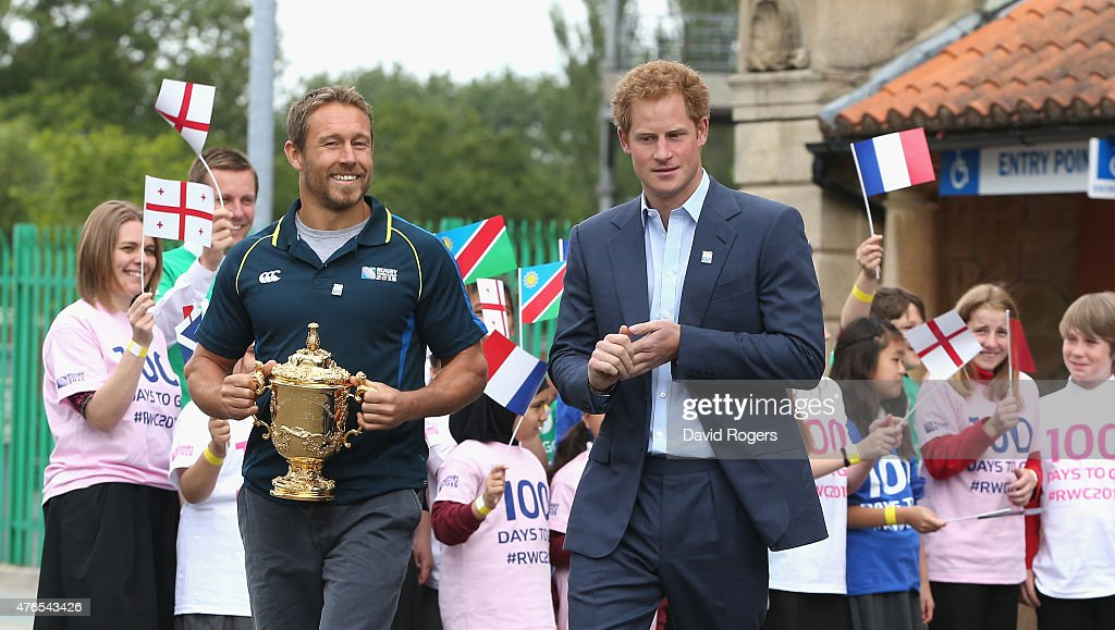Prince Harry (R) walks with England World Cup winner Jonny Wilkinson as he carries the Webb Ellis Trophy at the Launch of the Rugby World Cup Trophy Tour at Twickenham Stadium on June 10, 2015 in London, England.