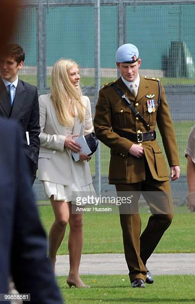 Prince Harry walks with girlfriend Chelsy Davy following his pilot course graduation at the Army Aviation Centre on May 7 2010 in Andover England