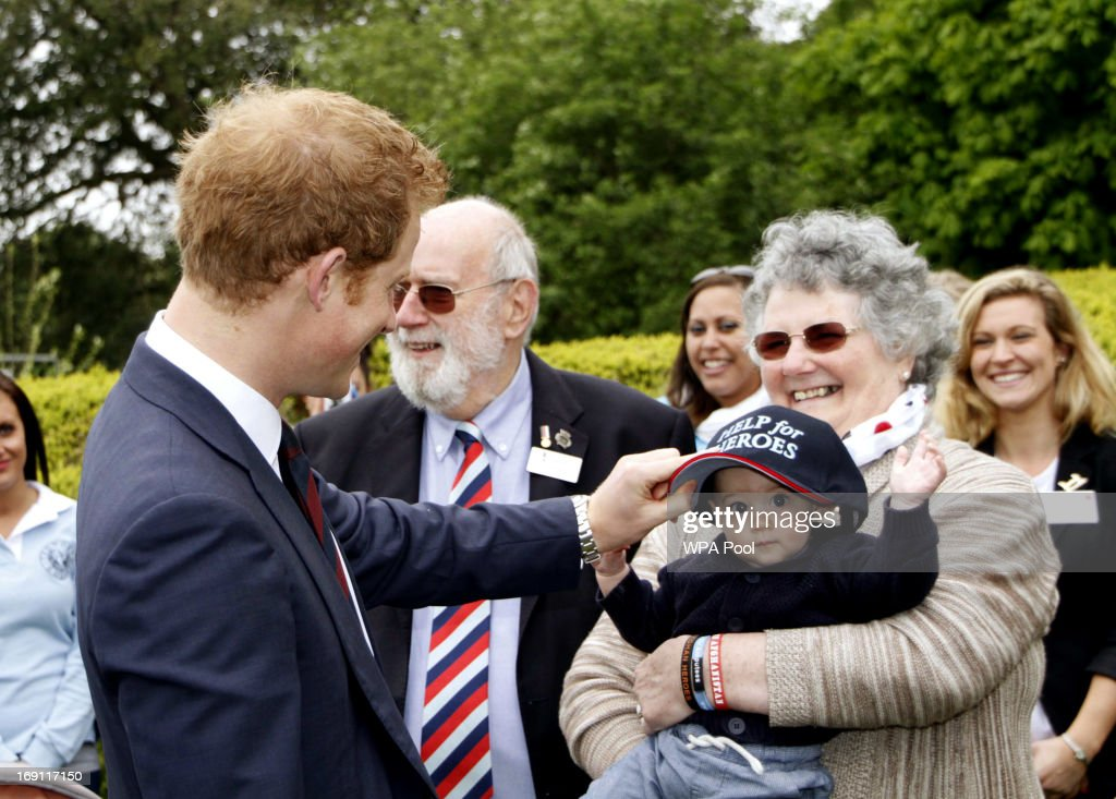Prince Harry was presented with a baseball cap, but handed it to a young child during his visit Tedworth House to officially open the charity's Tedworth House recovery centre on May 20, 2013 in Tidworth, England. During their visit the two Royal Princes met with wounded veterans, serving personnel, and their families. Tedworth House in Wiltshire is one of four new units in England which will offer respite care and rehabilitation to injured and sick service personnel, veterans and their families.