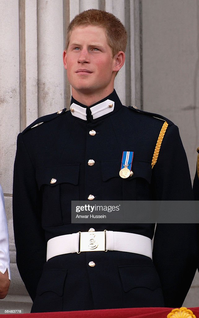 Prince Harry watches the flypast over the Mall of British and US World War II aircraft from the balcony of Buckingham Palace on National Commemoration Day, July 10, 2005, in London, England.