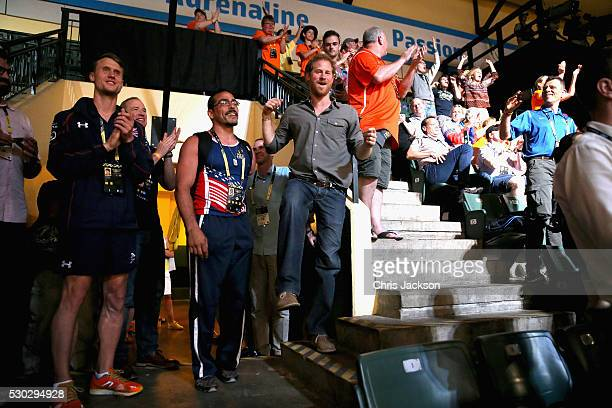 Prince Harry watches USA and GBR sitting volleyball teams compete in the finals with USA athlete Michael Kacer during the Invictus Games Orlando 2016...
