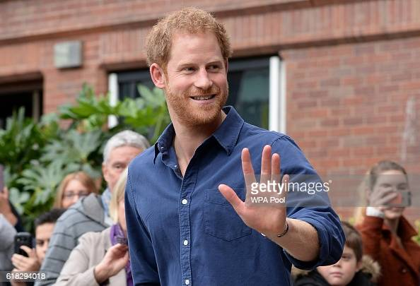 Prince Harry waves as he leaves Nottingham's new Central Police Station on October 26 2016 in Nottingham England