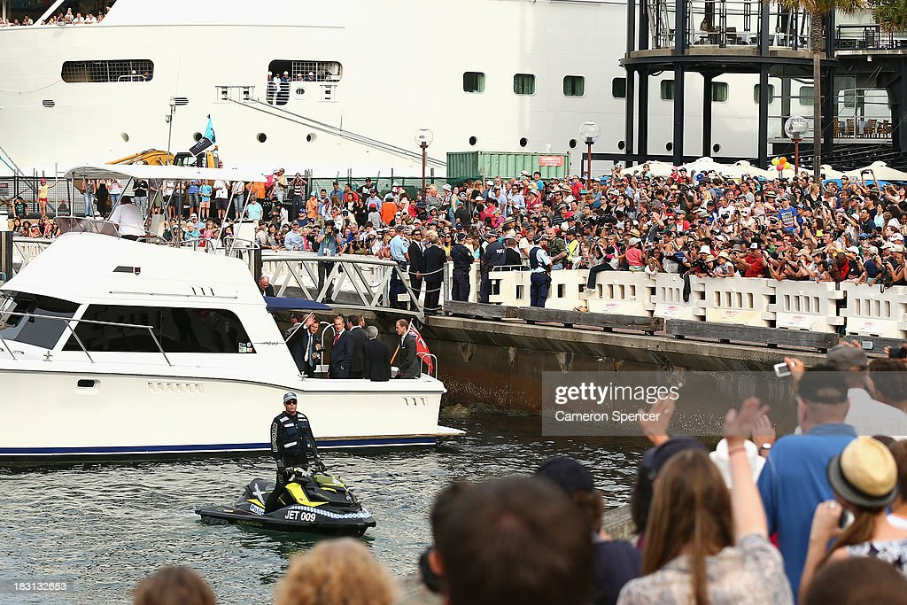 Prince Harry waves to spectators after boarding a boat bound for Kirribilli during the International Fleet Review on October 5, 2013 in Sydney, Australia. Over 50 ships participate in the International Fleet Review at Sydney Harbour to commemorate the 100 year anniversary of the Royal Australian Navy's fleet arriving into Sydney. Prince Harry is an official guest of the Australian Government and will take part in the fleet review during his two-day visit to Australia.