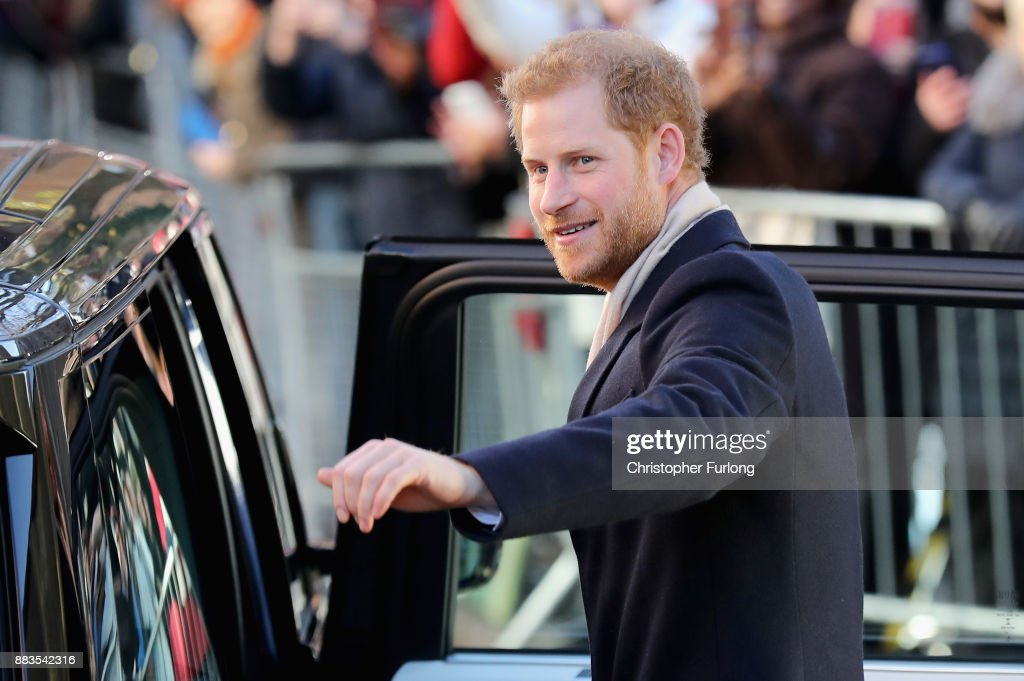 Prince Harry waves to the crowd as he departs Nottingham Contemporary alongside Meghan Markle on December 1, 2017 in Nottingham, England. Prince Harry and Meghan Markle announced their engagement on Monday 27th November 2017 and will marry at St George's Chapel, Windsor in May 2018.