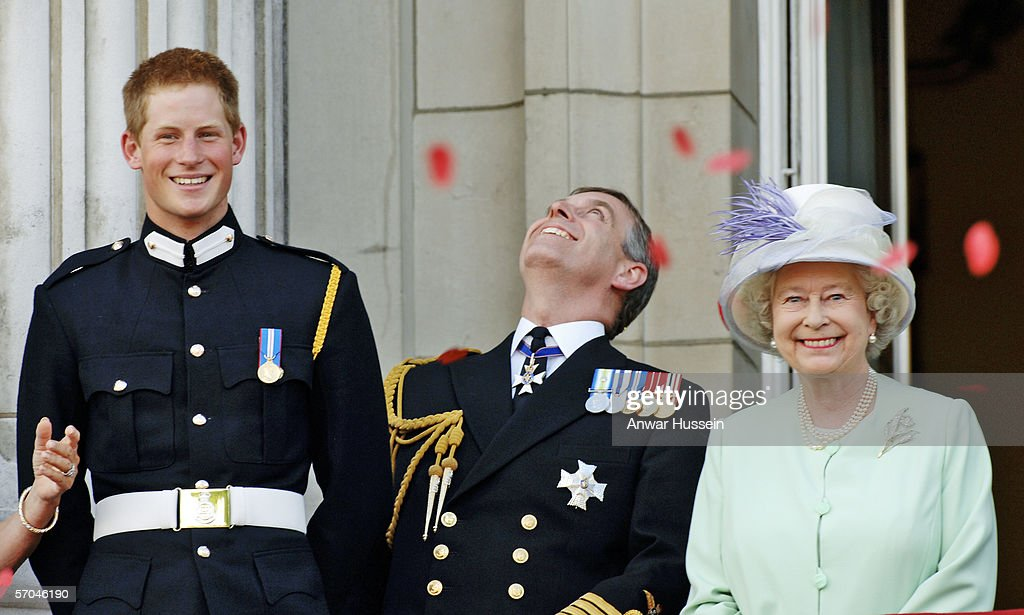 <a gi-track='captionPersonalityLinkClicked' href=/galleries/search?phrase=Prince+Harry&family=editorial&specificpeople=178173 ng-click='$event.stopPropagation()'>Prince Harry</a> wearing his Sandhurst army uniform, <a gi-track='captionPersonalityLinkClicked' href=/galleries/search?phrase=Prince+Andrew+-+Duc+d%27York&family=editorial&specificpeople=160175 ng-click='$event.stopPropagation()'>Prince Andrew</a> the Duke of York and HM Queen Elizabeth ll watch the flypast over The Mall of British and US World War II aircraft from the Buckingham Palace balcony on National Commemoration Day July 10, 2005 in London. Poppies were dropped from the Lancaster Bomber of the Battle Of Britain Memorial Flight as part of the flypast.