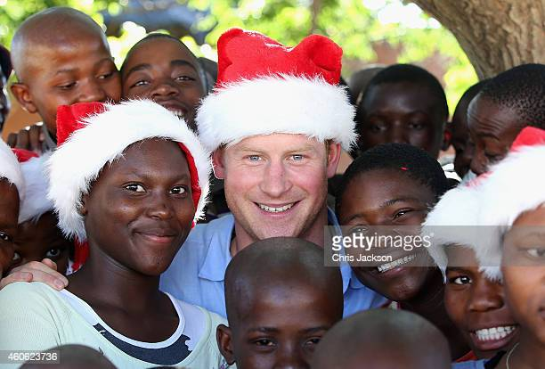 Prince Harry wears a Christmas hat with orphans from the Mants'ase Children's Home during a visit on December 5 2014 in Maseru Lesotho Prince Harry...