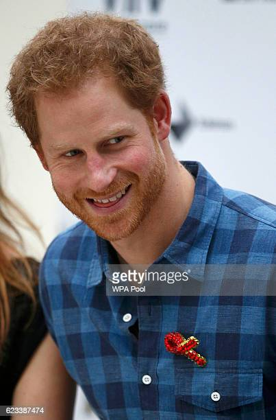 Prince Harry wears a specially made red brooch from a member of the 'Joyful Noise' choir a creation of NAZ a sexual health charity for minority...