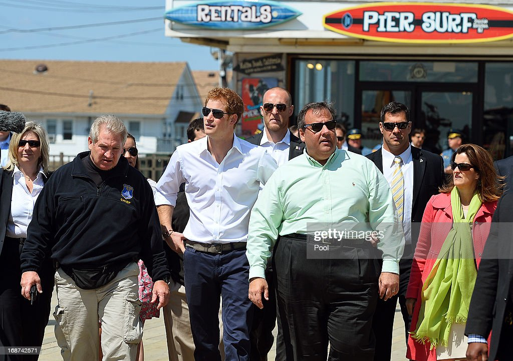 HRH <a gi-track='captionPersonalityLinkClicked' href=/galleries/search?phrase=Prince+Harry&family=editorial&specificpeople=178173 ng-click='$event.stopPropagation()'>Prince Harry</a> with Governor of New Jersey <a gi-track='captionPersonalityLinkClicked' href=/galleries/search?phrase=Chris+Christie&family=editorial&specificpeople=6480114 ng-click='$event.stopPropagation()'>Chris Christie</a> (3R) during his visit to Mantoloking, one of the areas affected by Superstorm Sandy on the fifth day of his visit to the United States on May 14, 2013 in Ocean Heights, New Jersey. HRH will be undertaking engagements on behalf of charities with which the Prince is closely associated on behalf also of HM Government, with a central theme of supporting injured service personnel from the UK and US forces.