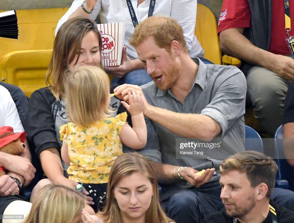 Prince Harry with Hayley Henson, wife of British Paralympian Dave Henson and their two-year-old daughter Emily attend the Seated Volleyball on day 5 of the Invictus Games Toronto 2017 at Mattamy Athletic Centre on September 27, 2017 in Toronto, Canada. The Games use the power of sport to inspire recovery, support rehabilitation and generate a wider understanding and respect for the Armed Forces.