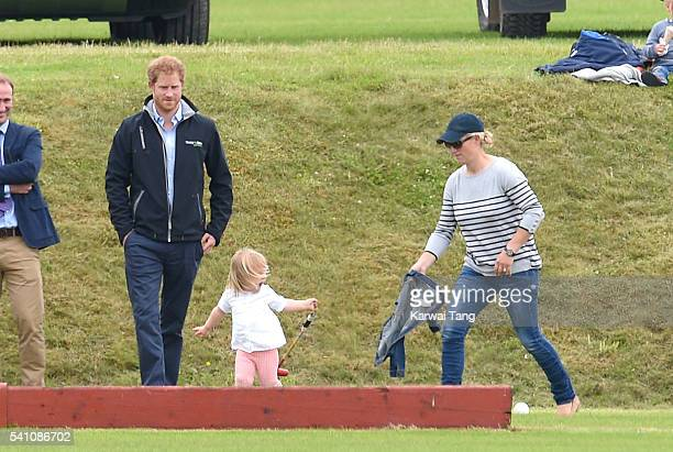 Prince Harry Zara Phillips and daughter Mia attend the Maserati Royal Charity Polo Trophy during the Gloucestershire Festival of Polo at Beaufort...