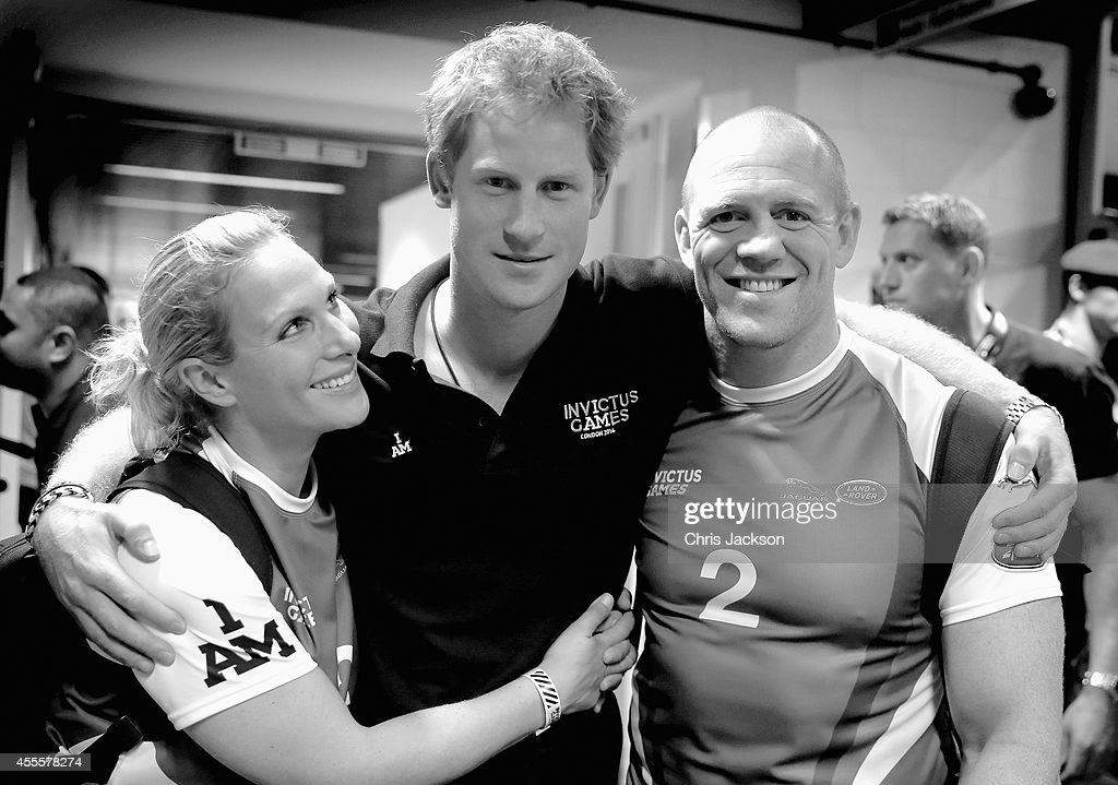 Prince Harry Zara Phillips and Mike Tindall pose for a photograph after competing in an Exhibition wheelchair rugby match at the Copper Box ahead of...
