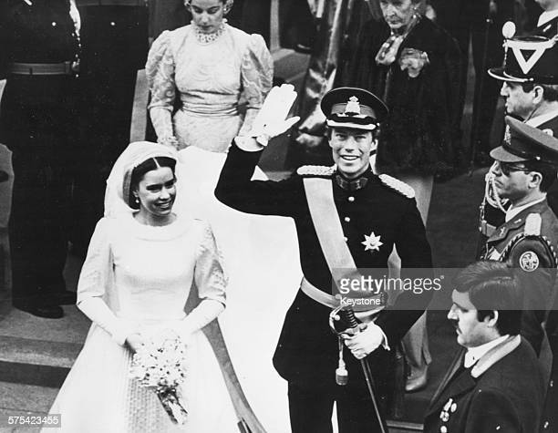 Prince Henri of Luxembourg waving to the crowd with his bride Maria Theresa leaving the cathedral following their wedding ceremony Luxembourg...