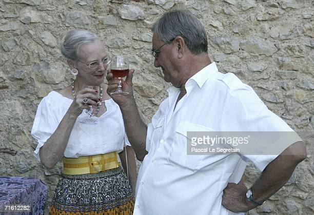 Prince Henrik of Denmark makes a toast with Queen Margrethe II of Denmark during the annual photocall in their summer residence on August 9 2006 in...