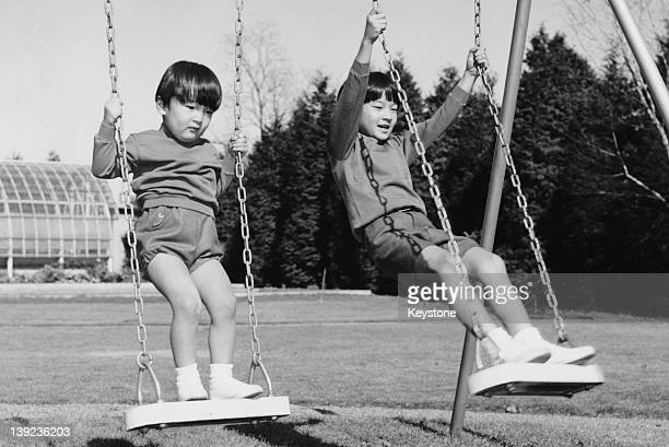Prince Hiro aka Crown Prince Naruhito of Japan and his younger brother Prince Aya aka Prince Akishino in the grounds of Togu Palace Tokyo 1968